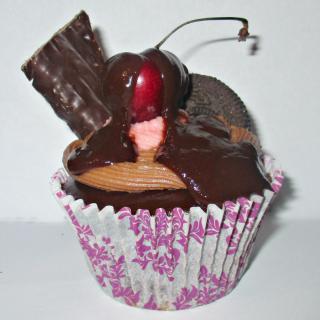 A ganache cherry ripe cupcake